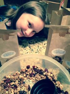 The newest batch of Garnet Granola and the granola company's CEO.