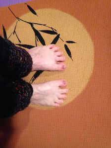 My feet, toes spread enthusiastically, on one of my favorite yoga mats.